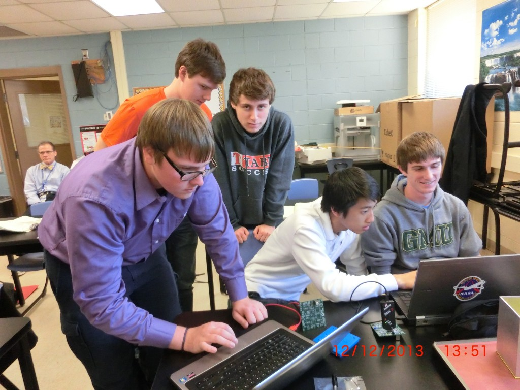 PM Team members: Richard Kazmer, Bobby Smyth, Danny McMahara, Correy Xu, Stephen Haggard work diligently on designing the device