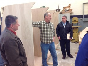Tim Extine (c) shows the progress on the cabinetry components (2.14.14).