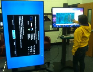 Shelby Giddings creates a painting on the touch screen monitor.