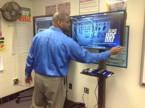 "Dhyronn Goggins, Electronics Instructor, reviewed his students' work on the 75"" vertical television monitor (l) and the 42"" touch screen monitor (r).  We have the exact same monitors and stands."