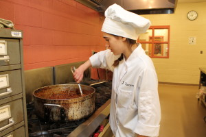 NASA HUNCH student stirring up vegetarian chili for the culinary challenge event