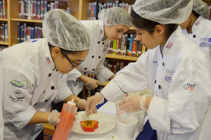 Culinary Arts students prepare samples of their Red Pepper Puree Risotto to be judged as an entry in the NASA Culinary Challenge.